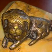 Antique inkwell in the form of a bronze dog on a stand